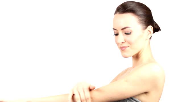 Woman moisturising video