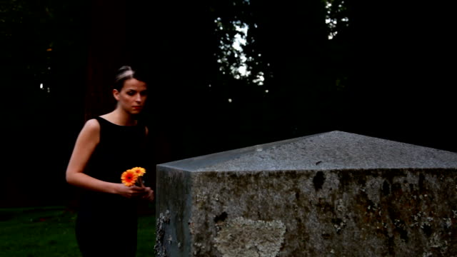 Woman mourns at grave video