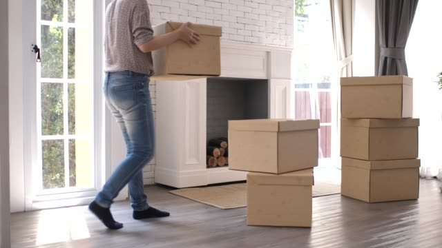 woman moving box to new home - portare video stock e b–roll