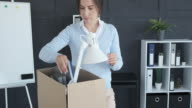 istock Woman moving into new office 1179159259