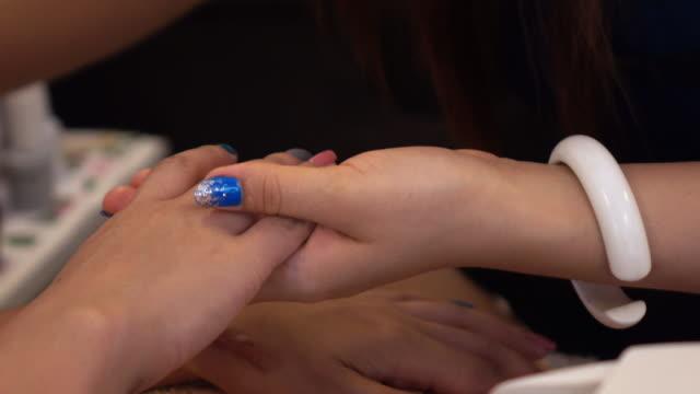 woman nail manicure in beauty salon video