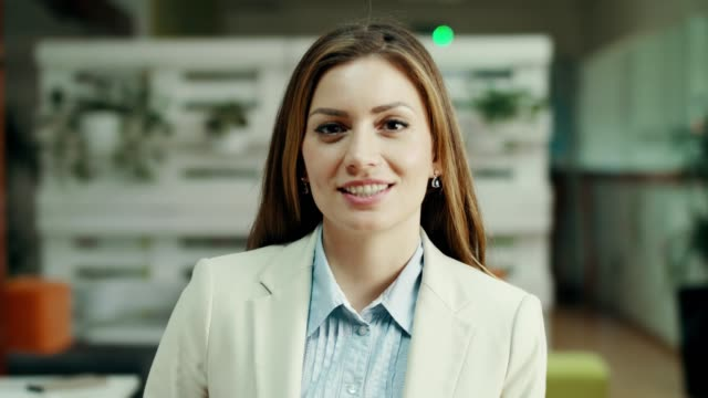 Woman on a job interview Portrait of a young woman talking and introducing herself on a job interview. interview event stock videos & royalty-free footage