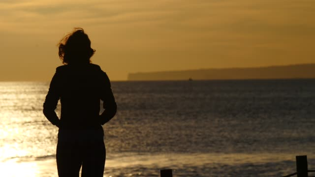 Woman on beach at morning. video