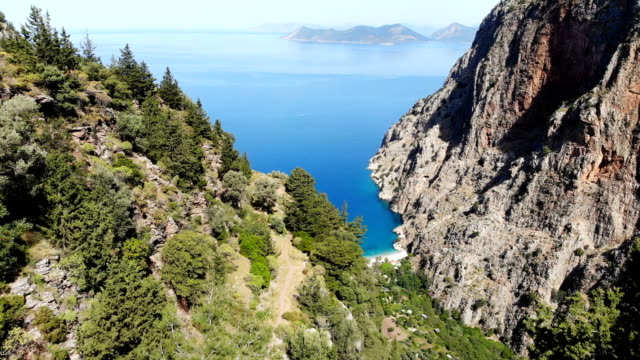woman on bike in the valley. butterfly valley from oludeniz. fethiye, turkey. - fethiye video stock e b–roll