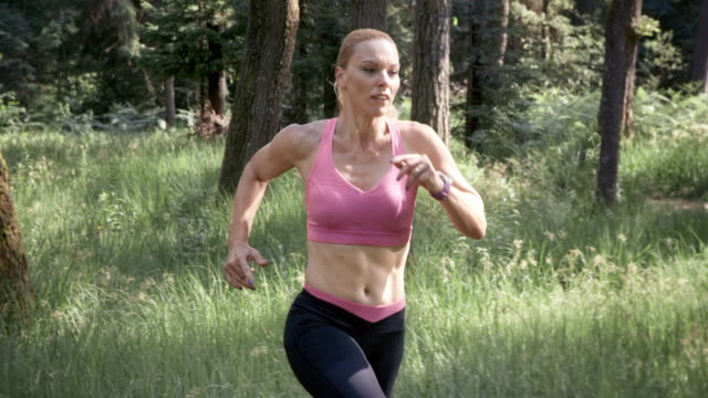 SLO MO DS Woman on her run through the forest video