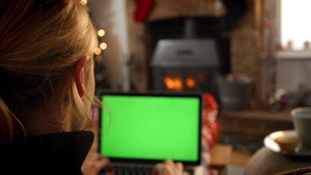 Woman On Line With Laptop In Room Ready For Christmas video