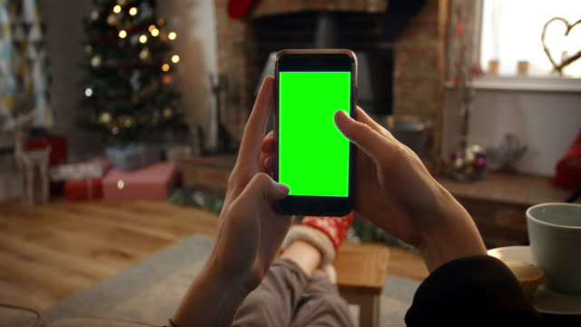 Woman On Line With Mobile Phone In Room Ready For Christmas video