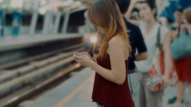 woman on phone at station woman on phone at station railroad station platform stock videos & royalty-free footage