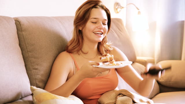 woman on sofa with fresh cake video
