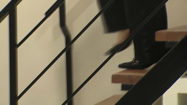 Woman on stiletto heels moves up and down on staircase video