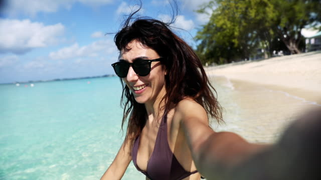 Woman on the beach - Amazing vacation in wintertime in the Caribbean Sea - Cayman Islands video