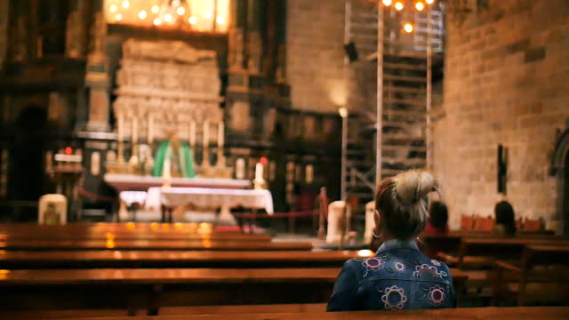 Woman on the bench in cathedral video