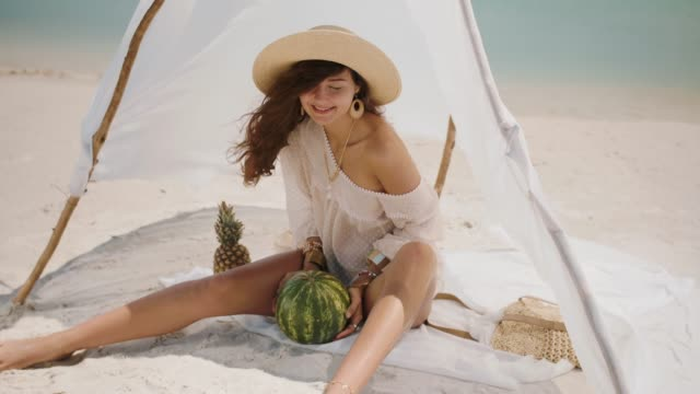 Woman on the Tropical Beach Eating Watermelon