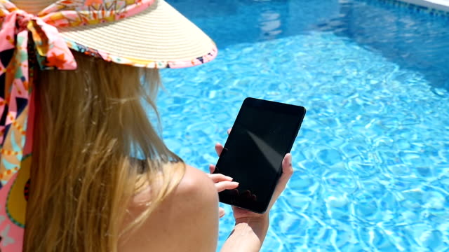 Woman on vacation using tablet video