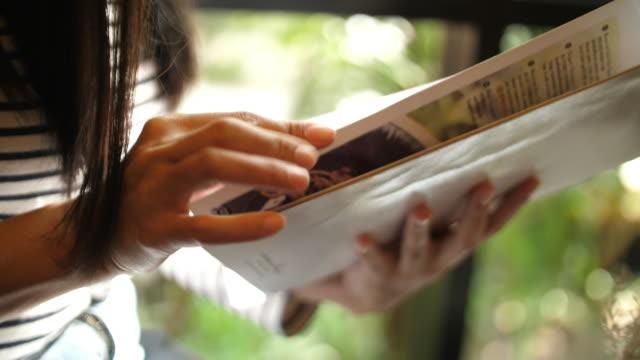 Woman open A Menu at Restaurant Woman open A Menu at Restaurant menu stock videos & royalty-free footage