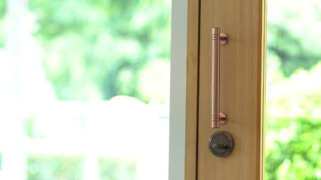 woman open the glass door and coming inside. - entrata video stock e b–roll