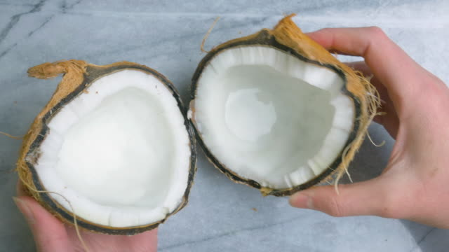 Woman Opening a Coconut in 4k video