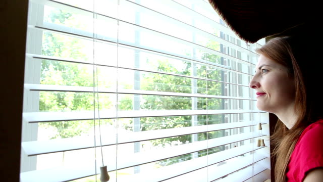Woman Opening Blinds And Enjoying View video