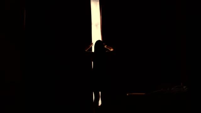 Woman opening curtains Woman opening curtains light natural phenomenon stock videos & royalty-free footage