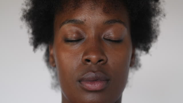 woman opening her eyes and looking at camera - body positive video stock e b–roll