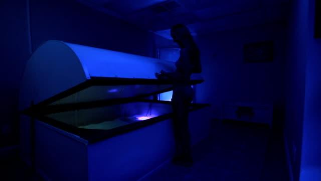 woman opens sensory deprivation tank video