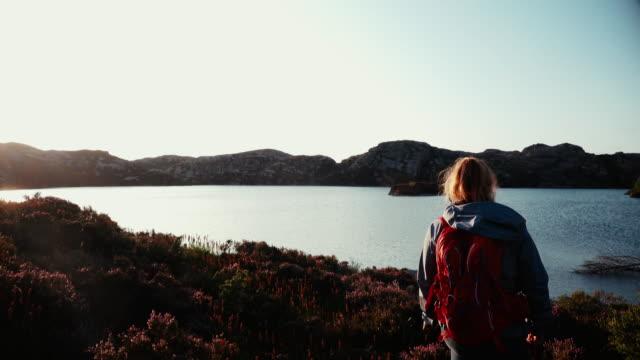 Woman outdoor adventures: hiking in Norway