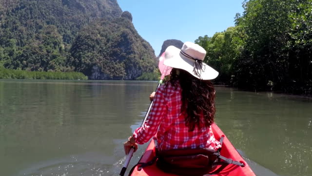 Woman Paddling Kayaking In Beautiful Lagoon Action Camera POV Of Girl Sitting On Kayak Boat video
