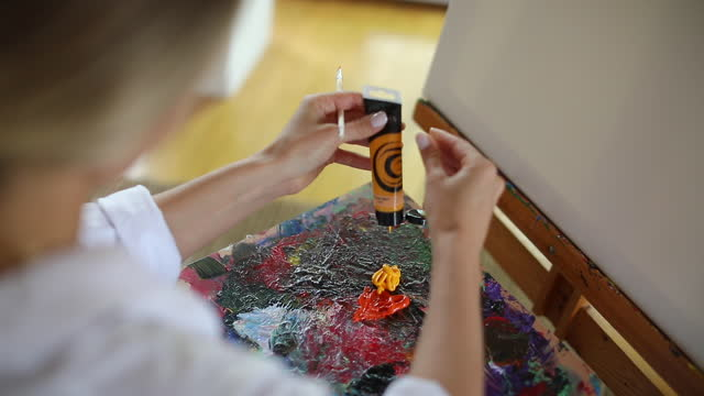 Woman painter mixing colors video