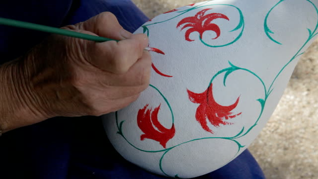 woman paints a calabash woman paints a calabash painting art product stock videos & royalty-free footage