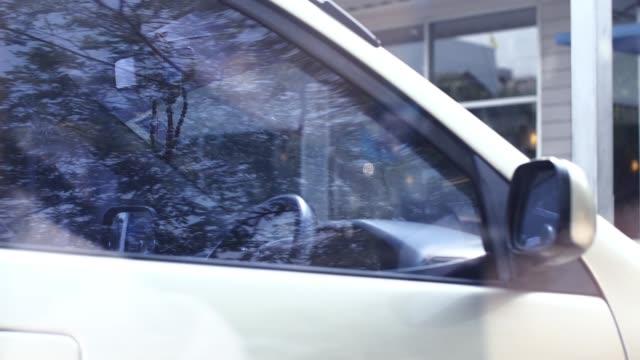 woman parking a car and preparing stuff video