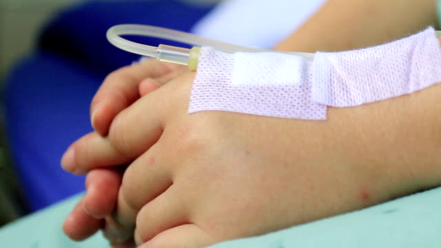 woman patient in hospital with saline iv video