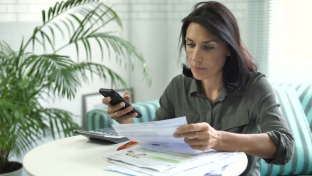 Woman Paying Bill on Smart phone, Mobile Payment