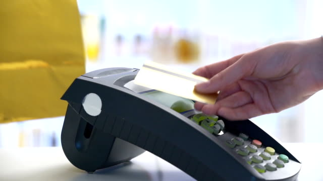 woman paying through smartphone using nfc technology. close up - contactless payment stock videos & royalty-free footage