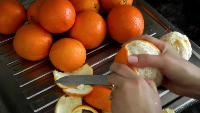 woman peeling oranges video