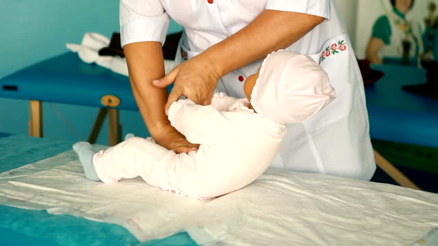 woman performing CPR on baby training doll with one hand compression video