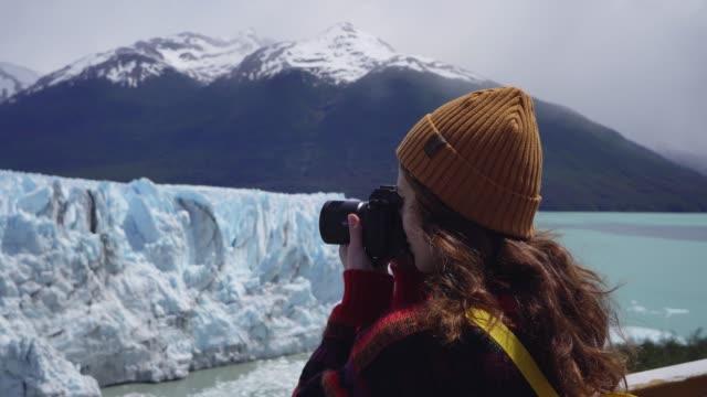 Woman photographing  scenic view of Perito Moreno Glacier in Patagonia