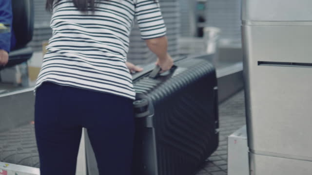 Woman Placing Baggage at Check-in Counter
