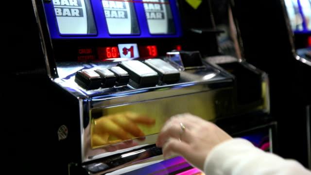 Woman Playing A $1 Slot Machine video