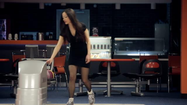 Woman playing bowling video