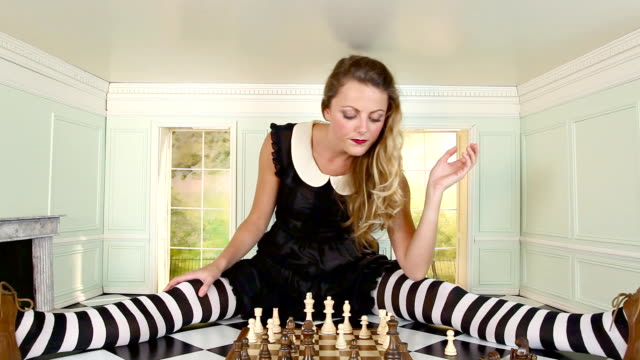 Woman playing chess video
