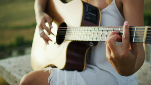 woman playing guitar - musician stock videos and b-roll footage