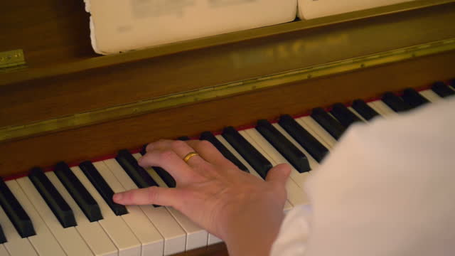Woman playing piano in slow motion 180fps