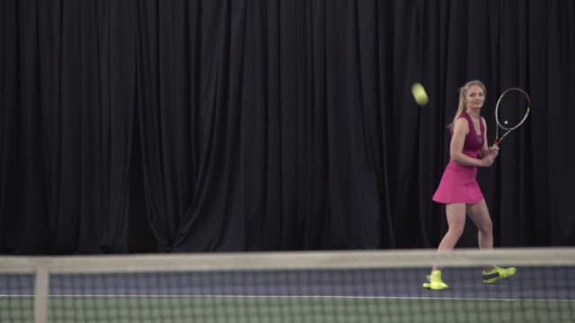 Woman playing tennis video