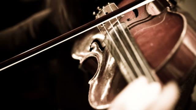 Woman playing violin in symphony orchestra video