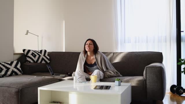 Woman PMS at home