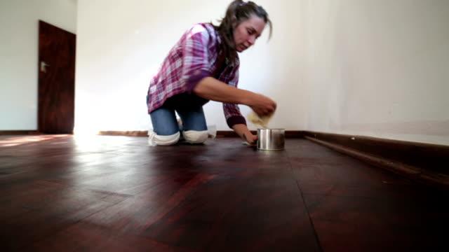 Woman polishing wooden floor video