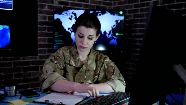 woman portrait soldier with computer, IT war, cyber safety video
