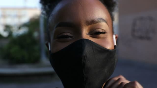 Woman portrait wearing a black cloth face mask Woman portrait wearing a black cloth face mask covid mask stock videos & royalty-free footage