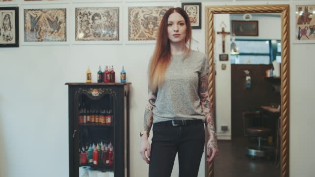 Woman posing in tattoo studio video