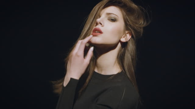 Woman posing on black background video